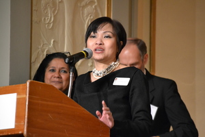 Woman speaking behind a podium