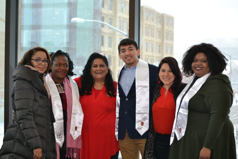 students and staff at graduation reception