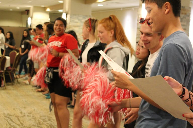 students with pom poms at orientation